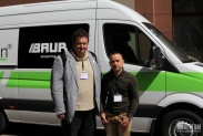 Участники конференции на фоне лаборатории BAUR titron